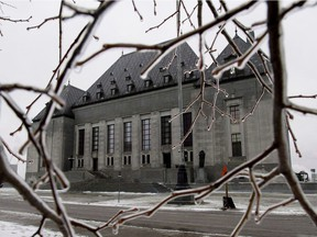 Ice coats tree branches outside of the Supreme Court of Canada in Ottawa. Should the justices keep their internal arguments to themselves when they agree on the verdict but not on the reasons?