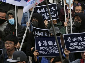 Pro-independence demonstrators march during an annual New Year protest in Hong Kong on Jan. 1, 2019.