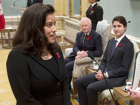 Governor General David Johnston and Prime Minister Justin Trudeau watch as Jody Wilson-Raybould is sworn in as Minister of Justice and Attorney General of Canada on Nov. 4, 2015. less than four years later, she's out of cabinet.