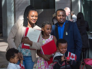 Amarech Yemane Habtemariam poses with her family for a photo after she and her daughter Salem Kassahun Sisay became Canadian citizens during a special community citizenship ceremony held in the Great Hall at the National Gallery of Canada. Her husband is Kassahun Mengesha and the boys are Enoch Sisay, 4, and Marken Sisay, 2.
