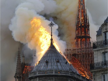 Flames burn the roof of the landmark Notre-Dame Cathedral in central Paris on April 15, 2019, potentially involving renovation works being carried out at the site, the fire service said. - A major fire broke out at the landmark Notre-Dame Cathedral in central Paris sending flames and huge clouds of grey smoke billowing into the sky, the fire service said. The flames and smoke plumed from the spire and roof of the gothic cathedral, visited by millions of people a year, where renovations are currently underway.