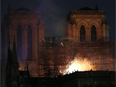 Notre Dame cathedral is burning in Paris, Monday, April 15, 2019. A catastrophic fire engulfed the upper reaches of Paris' soaring Notre Dame Cathedral as it was undergoing renovations Monday, threatening one of the greatest architectural treasures of the Western world as tourists and Parisians looked on aghast from the streets below.