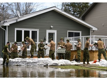 Soldiers work to hold back floodwaters on the Ottawa River in Cumberland. Ontario on Tuesday, April 30, 2019.