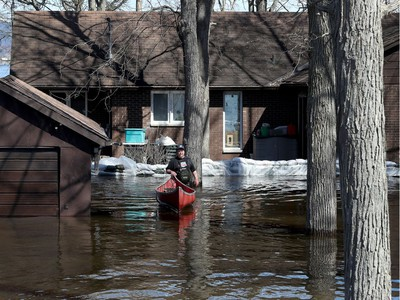 Water continued to rise in Constance Bay on Tuesday and the city announced a voluntary evacuation of about 150 homes along Bayview Drive.