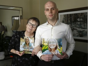 Jennifer Richards and her son Simon pose with a photo of Lauren Richards  in Ottawa Wednesday March 27, 2019. Lauren died Feb. 21.