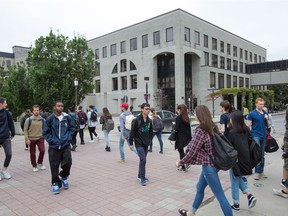 Students at the University of Ottawa: There are several ways the city can be more youth-friendly.     (Photo Wayne Cuddington/ Postmedia)