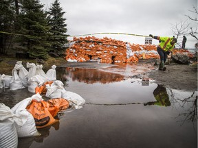 Crews were on site of the berm near Jamieson Street along the Ottawa River in the Britannia area, Thursday, May 2, 2019.