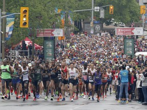 Runners leave the start line of the marathon at the Ottawa Race Weekend on Sunday, May 26, 2019.