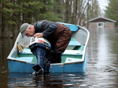 Richard Bergeron returns by boat to feed his cats that are staying in his garage on higher ground on Edgewater Trail — a small enclave of waterfront homes in the Whitewater municipality about 20 minutes east of Pembroke. His house is fully under water. Of the 11 homes on this street, nine are now abandoned.