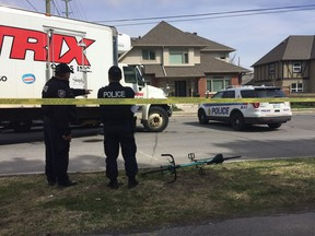 A cyclist was in critical condition after she was struck by a delivery truck and trapped underneath its wheels near Parkdale Avenue and Ruskin Street Tuesday morning.