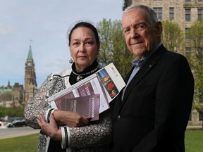 Donna Andrew and Gordon Miller were  kicked out of a symposium on the Official Languages Act and they believe it's for political reasons. They belong to a group that opposes official bilingualism.