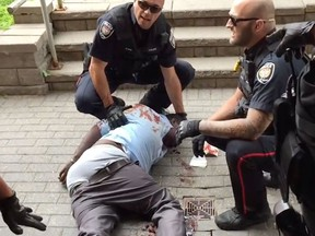 Youtube video screen grabs of Abdirahman Abdi with Const. Daniel Montsion on right, Const. Dave Weir on the left.