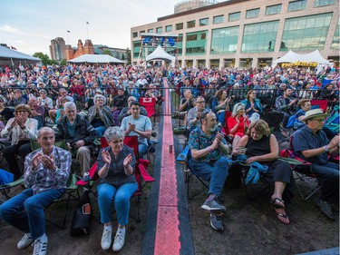 Fans applaud as singer Judith Hill opens the 39th edition of the TD Ottawa Jazzfest at Marion Dewar Plaza in front of Ottawa City Hall. Photo by Wayne Cuddington / Postmedia