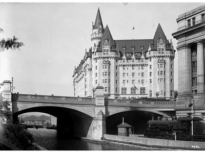 Chateau Laurier Hotel and the Grand Trunk Railway Central Station in a photograph taken from the old Bates Warehouses near where the National Arts Centre is located today.