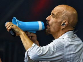 """Singer Tim Booth performs with the band """"James"""" at Bluesfest in Ottawa on Sunday, July 7, 2019.   0708 Bluesfest 01  Photo by Patrick Doyle / Postmedia"""