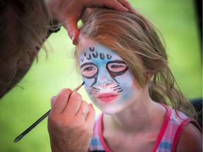 Maève Serviss who will soon be turning nine, gets her face painted as a funky leopard at a 'Very Merry Unbirthday Party' at Larkin Park Saturday celebrating children who struggle with friendships and don't always get invited to birthday parties. Saturday, July 27, 2019.