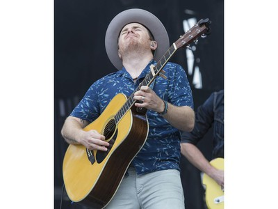 Gone West member Jason Reeves performing on the city stage following a severe thunderstorm that blew through Ottawa on day 7 of RBC Bluesfest. Photo by Wayne Cuddington/ Postmedia