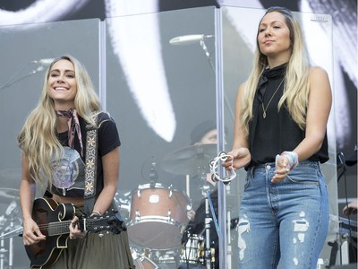 Gone West members (from left) Nelly Joy and Colbie Caillat performing on the city stage following a severe thunderstorm that blew through Ottawa on day 7 of RBC Bluesfest. Photo by Wayne Cuddington/ Postmedia