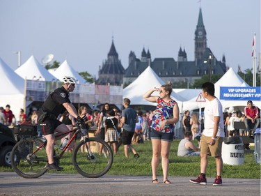 Music fans arrive as the 25th anniversary edition of RBC Bluesfest gets underway on the grounds of the Canadian War Museum in Lebreton Flats. Photo by Wayne Cuddington/ Postmedia