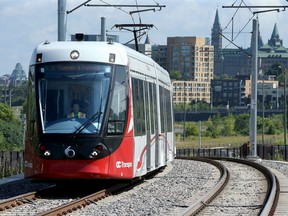 With Parliament Hill as a backdrop, an LRT train on a test run pulls into Bayview station on Thursday (August 8, 2019).