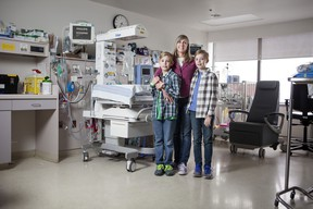 Liam and Rhys White with their mother Nora Shipton in the NICU where they spent the first two and a half months of their lives.