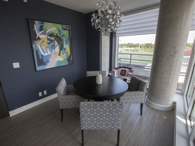 Jeff Hunt, co-owner of the Ottawa Redblacks, is selling his luxurious condo that overlooks TD Place. The dining area. P