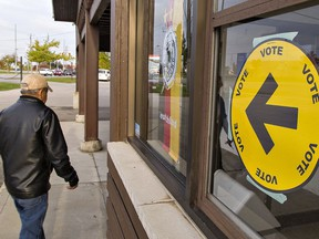 Voters head to a polling station in Brantford for Monday's federal election. How well did the outcome actually reflect the way Canadians voted?