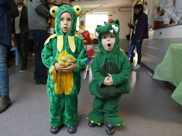 Dominik, 4, a frog, and Simon, 2, a dragon, pose for a photo at the Westcliffe Community Association Annual Halloween Party.