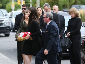 Shawna Button arrives at the memorial for her late husband Thomas Roberts at the Ottawa Police Association, October 07, 2019.
