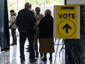 Voters enter the advance polling station at Ottawa City hall on Friday.