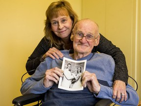 Donna Bertrand and her father, Charles Diffin  with wedding photo of Diffin and his bride Joan.