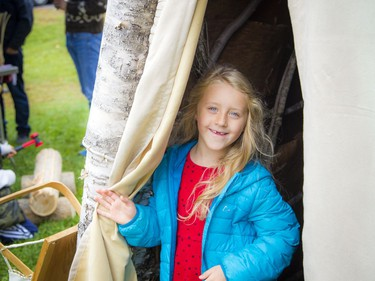 """Anishinabe Nibin, or """"Algonquin summer,"""" was celebrated in Gatineau Park on Saturday, Oct. 12, 2019, where people could learn more about the traditional Algonquin way of life, as well as a chance to see artisans at work. Six-year-old Zoé Delarosbil-Proulx checks out the birchbark wigwam.   Ashley Fraser/Postmedia"""