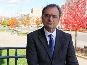 Queen's University interim provost and vice-president (academic) Tom Harris outside Richardson Hall in Kingston on Wednesday. (Steph Crosier/The Whig-Standard)