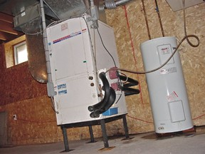Upgrading an old furnace can lead to energy savings of hundreds of dollars a year. This forced-air natural gas furnace is also connected to central air conditioning.