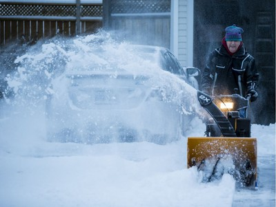 Ian MacNeil snowblows a neighbour's driveway after the first significant snowfall of the season in Ottawa. November 12, 2019.