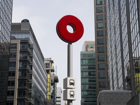 OC Transo signage for the bus and LRT by the Parliament station at Sun Life Financial Centre on Queen and O'Connor street. Tuesday, March 5, 2019.