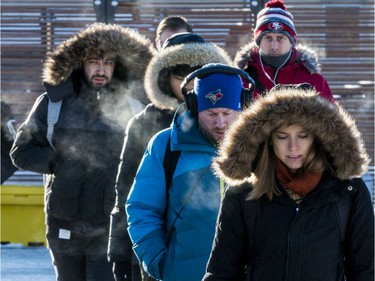 Ottawa residents deal with record low temperatures on their way to work at Tunney's Pasture. November 13, 2019.