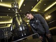 Winnipeg Blue Bombers quarterback Zach Collaros checks out the Grey Cup in advance of Sunday's CFL championship game against the Hamilton Tiger-Cats.