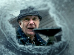Manotick resident Bob Caines at least had a sense of humour about getting his car on the road Monday after using some real elbow grease to get the ice from his windows first.  Julie Oliver/Postmedia