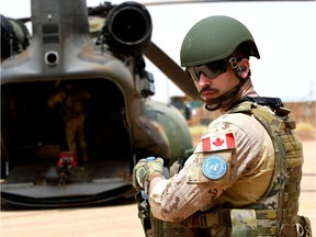 A Canadian UN soldier prepares to move out of a base in Gao on Aug. 1, 2018, as part of an operation in Mali. Canada declined a request to extend its presence there.