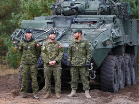 Canadian Army soldiers stand next to their LAV 6 armored personnel carrier during NATO enhanced Forward Presence battle group military exercise Silver Arrow in Adazi, Latvia October 5, 2019. REUTERS