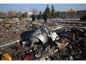 Rescue teams work amidst debris after a Ukrainian plane carrying 176 passengers crashed near Imam Khomeini airport in the Iranian capital Tehran early in the morning on Jan. 8, 2020