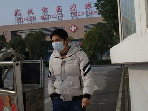 A man leaves the Wuhan Medical Treatment Centre, where a man who died from a respiratory illness was confined, in the city of Wuhan, Hubei province, on January 12, 2020. A 61-year-old man has become the first person to die in China from a respiratory illness believed caused by a new virus from the same family as SARS, which claimed hundreds of lives more than a decade ago, authorities said.