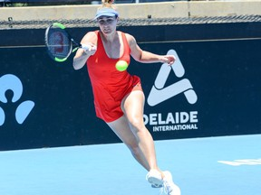 Gabriela Dabrowski of Canada hits a return against Daria Kasatkina of Russia during their first session women's singles match on day one of the ATP Cup Adelaide International tennis tournament in Adelaide on January 12, 2020.
