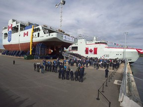 Shipbuilders, military personnel and others  attend the naming ceremony for Canada's lead Arctic and Offshore Patrol Ship, the future HMCS Harry DeWolf, at Halifax Shipyard in 2018.