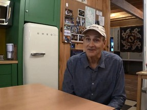Network Musician James Taylor, shown in his kitchen, sent a video message to a dying fan, Darrell Johnson, who is currently in palliative care.