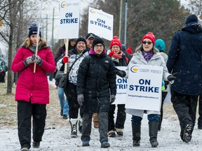 High school teachers and education workers on the picket line at Ridgemont High School in December.