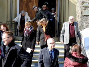 Mourners leave church after funeral services for Jeannette Runciman.