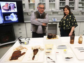 Stanley Anablak, President of Kitikmeot Iniut Association and Pamela Gross, President of Inuit Heritage, Trust look at recovered artifacts from the Franklin Expedition were shown at a press conference in Ottawa, February 20, 2020.  Photo by Jean Levac/Postmedia News assignment 133280