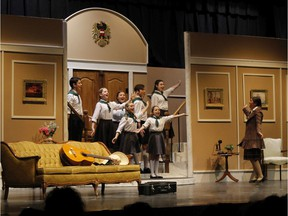 Maria Rainer played by Grace Cosgrove and the von Trapp children, during St. Mother Teresa High School's Cappies production of The Sound of Music, on Feb. 14, 2020, in Ottawa, On.